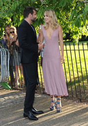 A pair of tropical-print platform sandals by Topshop added a funky feel to Suki Waterhouse's sophisticated outfit.