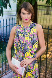Ella Catliff teamed a book clutch with a vibrant print dress for the Serpentine Gallery Summer Party.