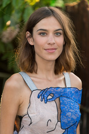 Alexa Chung attended the Serpentine Gallery Summer Party sporting unstyled shoulder-length waves.