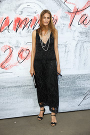 Yasmin Le Bon finished off her look with a pair of black bow sandals.