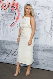 Ellie Goulding opted for a structured white midi dress by Jacquemus when she attended the Serpentine Summer Party 2018.