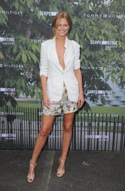 Champagne-hued T-strap heels rounded out Toni Garrn's look.