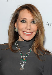 Marisa wore a decadent emerald and diamond necklace to the Van Cleef & Arpels opening gala.