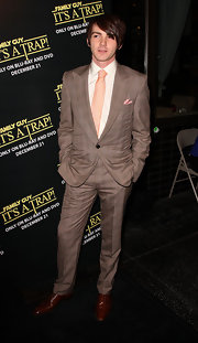Drake Bell brought a little flavor to the carpet in a striped brown suit and peach tie.