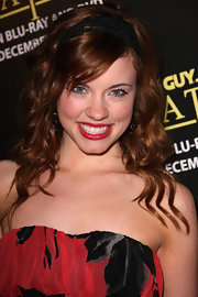 Molly Burnett showed off radiant red curls complete with a black headband at the 'Family Guy:It's A Trap' party.