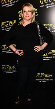 Melissa Joan Hart struck a pose in black leather sandals. She paired the platformed shoes with casual and monochromatic attire.