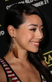 Aimee Garcia jazzed up her look with a brown feathered earring.