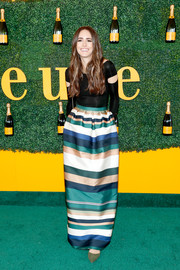 Louise Roe glammed up her top with a multicolored striped maxi skirt.