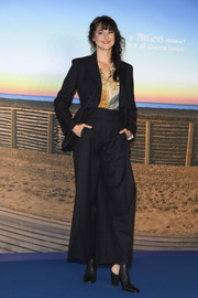 Shailene Woodley went masculine-chic in a black Ferragamo suit at the Deauville American Film Festival photocall.