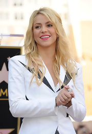 Shakira wore her long tresses in tousled waves when she was honored on the Hollywood Walk of Fame.