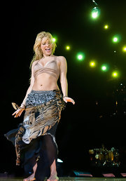 Shakira got hippy in a tiger print gypsy skirt while performing in Barcelona.
