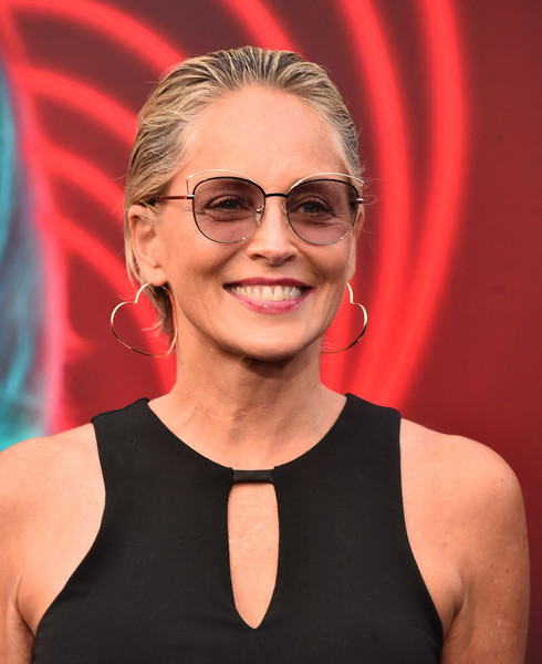 Sharon Stone Gold Hoops [the spy who dumped me,eyewear,hair,glasses,beauty,hairstyle,chin,blond,smile,vision care,arrivals,sharon stone,california,los angeles,fox village theater,lionsgate,premiere]