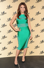 Eva Longoria showed off her slender petite frame in a figure-flattering green dress while making an appearance in NYC.