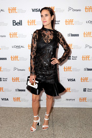 Jennifer Connelly kept up the monochrome motif with a Louis Vuitton box clutch.