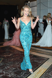 Sailor Brinkley Cook stood out so glamorously in a beaded turquoise gown at the Sherri Hill fashion show.