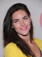 Hilary Rhoda's fuchsia lipstick made the perfect pairing with her bright lemon yellow sweater.