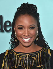 Shanola Hampton attended a Showtime event wearing her dreadlocks with a pompadour top and the sides pulled back.