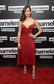 Emmy Rossum complemented her dress with strappy red heels by Chloe Gosselin.