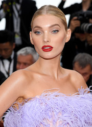Elsa Hosk highlighted her pout with a swipe of red lipstick.
