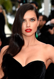 Adriana Lima dolled up her look with a sexy red lip.