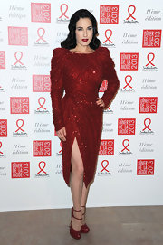 Dita Von Teese vamped it up at the Sidaction Gala Dinner in this stage-worthy red sequined dress.