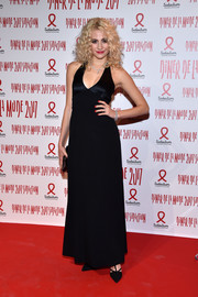 Pixie Lott opted for a simple black halter gown by Temperley London when she attended the 2017 Sidaction Gala.