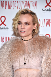 Diane Kruger highlighted her eyes with a heavy application of neutral shadow.