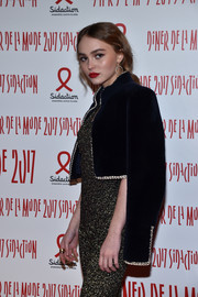 Lily-Rose Depp looked very mature and elegant wearing this midnight-blue velvet matador jacket at the 2017 Sidaction Gala.