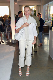 Kelly Rutherford completed her all-white look with a pair of Tamara Mellon Frontline sandals.
