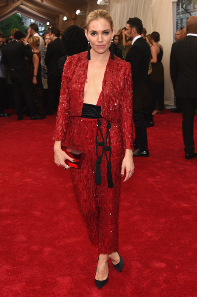 Sienna Miller Pantsuit [through the looking glass,flooring,fashion model,carpet,fashion,red carpet,formal wear,outerwear,dress,suit,haute couture,arrivals,sienna miller,china,new york city,metropolitan museum of art,costume institute benefit gala]
