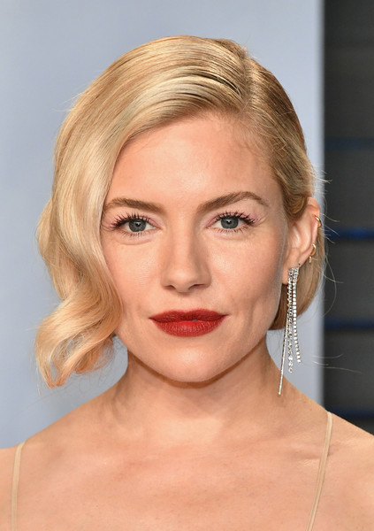 Sienna Miller Retro Updo [oscar party,vanity fair,eyebrow,face,blond,chin,skin,beauty,lip,cheek,human hair color,hairstyle,beverly hills,california,wallis annenberg center for the performing arts,radhika jones - arrivals,radhika jones,sienna miller]