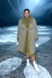 Paloma Elsesser layered a gray trench coat over a green dress for the Sies Marjan Fall 2019 show.