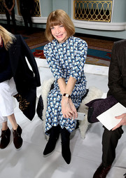 Anna Wintour sat front row at the Sies Marjan fashion show wearing a high-neck print dress and black suede boots.