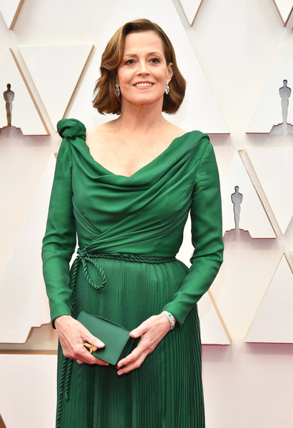 Sigourney Weaver Satin Clutch [clothing,green,dress,shoulder,cocktail dress,sleeve,neck,fashion,waist,fashion design,arrivals,sigourney weaver,hollywood,highland,california,92nd annual academy awards,sigourney weaver,dolby theatre,fashion,actor,red carpet fashion,92nd academy awards,red carpet,hollywoods biggest night,celebrity]