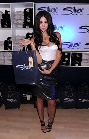Hope Dworaczyk wore black tripe strap sandals with metallic ankle cuffs to Maxim's Hot 100 Party.