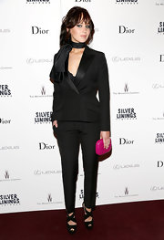A bright fuchsia clutch enlivened Jennifer's monochrome look.