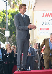 Simon Baker was all smiles in a classic gray suit while accepting a star on the Hollywood Walk of Fame.