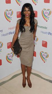 Sinitta chose a basic brown dress with side ruching and capped sleeves for her look at the Health Lottery Fundraising Event.