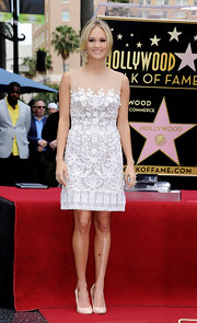 Carrie was sweet and girly while getting her star on the Hollywood Walk of Fame in a white embroidered frock. The retro silhouette with a modern design and sheer neckline was the perfect day time choice for the glamorous starlet.