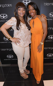 Regina King looked airy and chic in an orange halter dress with a keyhole neckline during an event at Bloomingdale's.