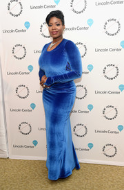Fantasia Barrino showed off her shape in a form-fitting blue velvet gown at the Sinatra Voice for a Century event.