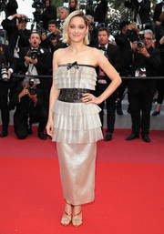Marion Cotillard went ultra girly in strapless gold Chanel Couture gown with ruffle detailing and a contrast waistband at the Cannes Film Festival screening of 'Sink or Swim.'