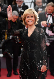 Jane Fonda paired a Roger Vivier beaded clutch with an ornately embellished dress for the Cannes Film Festival screening of 'Sink or Swim.'