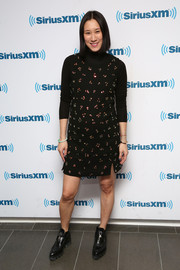 Eva Chen looked retro-cute in a beaded black maternity dress layered over a turtleneck during her SiriusXM interview.