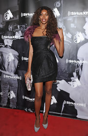 Jessica White showed off her long legs in a strapless cocktail dress with a gathered bodice design.