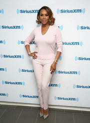 Vivica A. Fox was classic in a pink V-neck sweater while visiting SiriusXM's Town Hall.