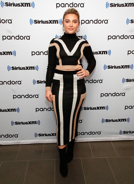 A pair of black mid-calf boots rounded out Florence Pugh's ensemble.