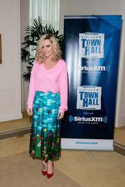 Jenny McCarthy looked ladylike in a pink cowl-neck blouse while attending SiriusXM's 'Town Hall' with the cast of 'Transformers: The Last Knight.'