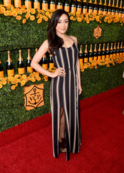 Aimee Garcia made a stylish appearance at the Veuve Clicquot Polo Classic in a black-and-white striped maxi dress.