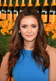 Nina Dobrev attended the Veuve Clicquot Polo Classic wearing her hair in a braided pompadour that cascaded into feathery waves.